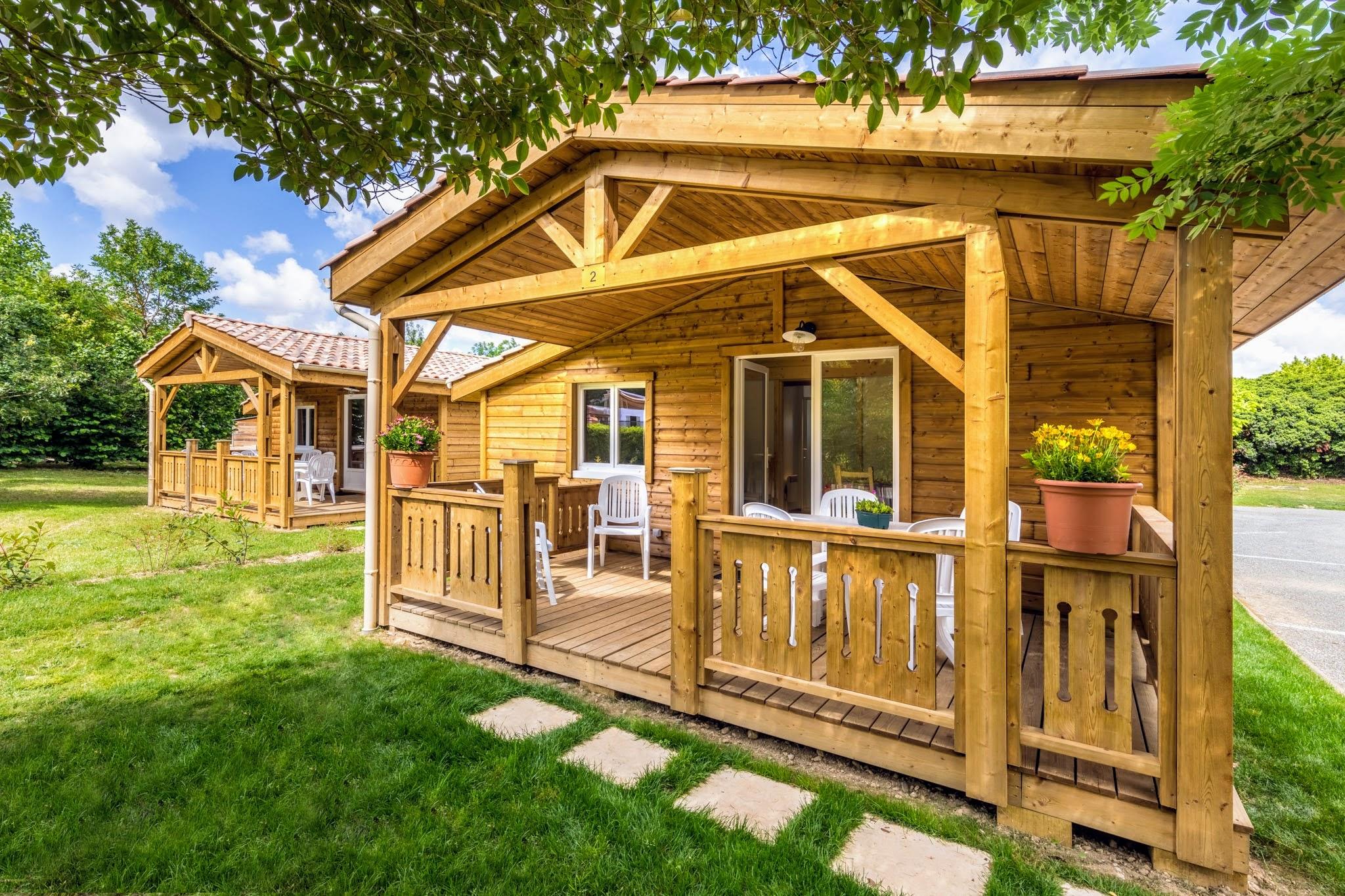 Location de chalet castres le camping tout confort for Chalet bois tarif